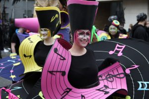 Music themed entertainers, music sheet costumes,